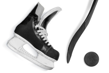 Hockey stick, skates and puck