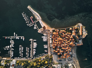 Montenegro. The old town of Budva. The view from the top. Orange roofs of the old town. The port of Budva.