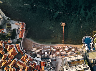 Montenegro. The old town of Budva. The view from the top. Orange roofs of the old town. Beach in the Adriatic sea