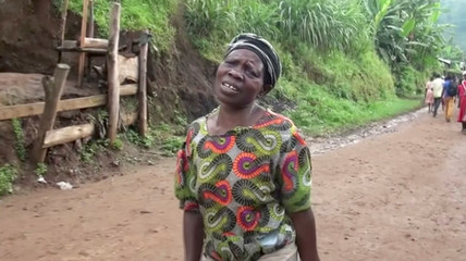 A woman cries after losing one of her children and having her house destroyed in a landslide in Bududa