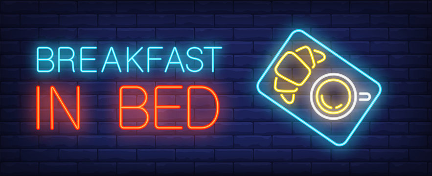 Breakfast in bed neon sign. Tray with coffee cup and croissant. Night bright advertisement. Vector illustration in neon style for hotel service, food delivery or cafe