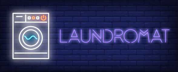Laundromat neon sign. Washing machine on brick background. Laundry, housework, chores. Night bright advertisement. Vector illustration in neon style for hygiene, housekeeping, service