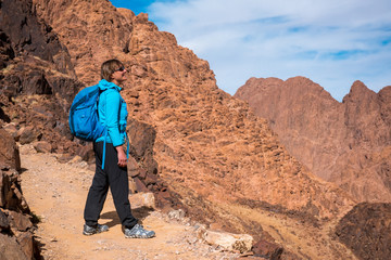 Woman Hiker with backpack enjoy view in desert