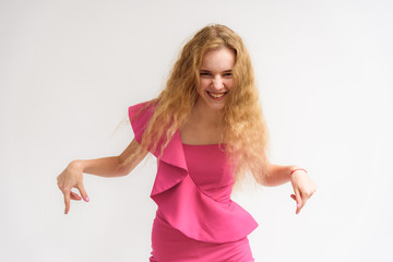 Studio portrait of a beautiful girl blonde teenager on a white background.