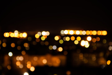 Light night at city bokeh blur abstract background. Colorful dark blue sky focus reflect flare wallpaper.