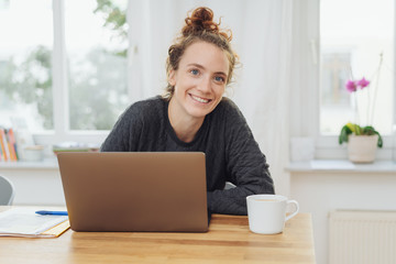 Happy young woman with a lovely warm smile