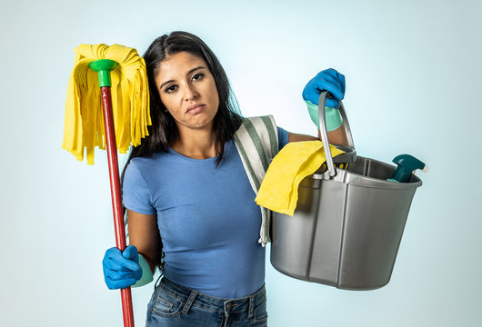 Attractive latin woman bored and restless of cleaning and house kipping