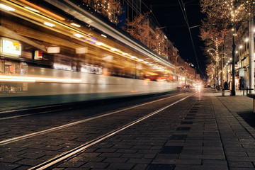 Time Exposure train traffic light night Mannheim street urban public transport city christmas holiday shopping asphalt
