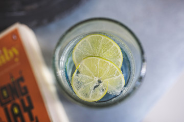 Glass of gin and tonic with lime, shot from above