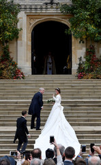 Britain's Princess Eugenie arrives accompanied by her father Prince Andrew, Duke of York, at St George's Chapel for her wedding to Jack Brooksbank in Windsor Castle, Windsor