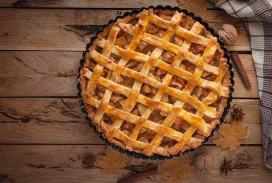 Homemade apple pie on wooden background, top view, copy space
