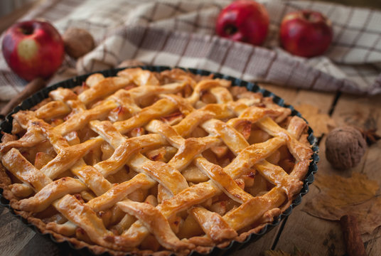 Close-up of homemade apple pie on wooden background