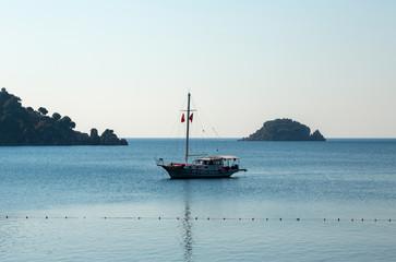 Yacht in bay of Icmeler village in Turkey