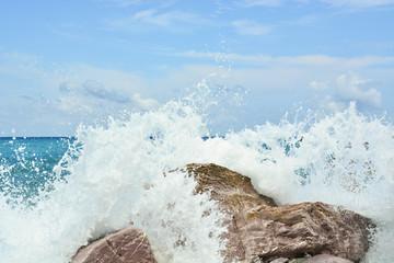 Waves splash against rocks on beach