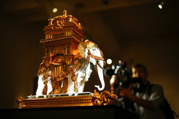 A man films 'The Baccarat Elephant Cave A Liqueur' during a photocall for 'The Midas Touch' collection Sotheby's in London
