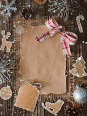 Christmas letter, list, congratulations on a wooden background. free space, mockup new Year. Spruce branches and decoration with their own hands. Cheap greetings