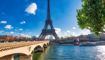PARIS, FRANCE - DECEMBER 2012: Tourists visit Eiffel Tower. The city attracts 40 million people every year