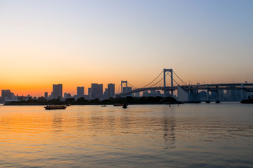 View of sunset and boats and rainbow bridge at sumida river sunset viewpoint ,tokyo