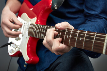 A man is playing the guitar.