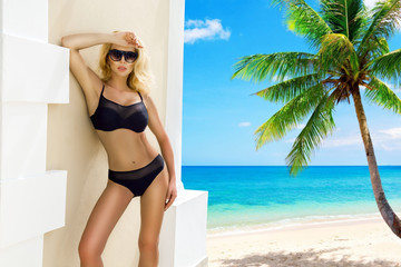 Beautiful sexy bikini woman, posing on the Caribbean beach