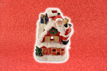 Santa Claus figurine stock images. Santa decoration on a red background. Christmas candlelight lamp. Vintage santa candle holder