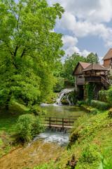 Rastoke village in green nature on Korana river, Croatia. Vertical.