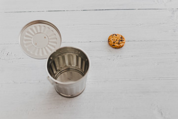 website cookie next to a trash can
