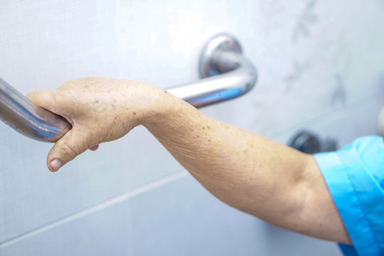 Asian senior or elderly old lady woman patient use toilet handle security in nursing hospital ward : healthy strong medical concept.