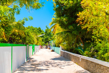 One of the central streets of small tropical island Hangnaameedhoo, Maledives. Copy space for text.
