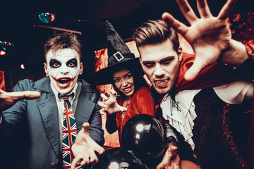 Wall Mural - Group of Friends in Halloween Costumes having Fun