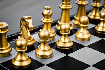 Gold chess pieces.