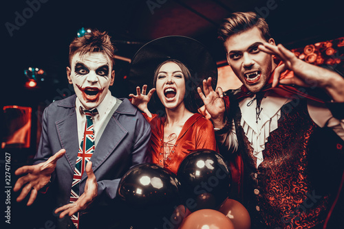 Young People in Costumes Celebrating Halloween