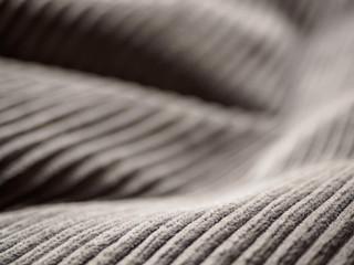 Closeup of folds of dark grey fabric