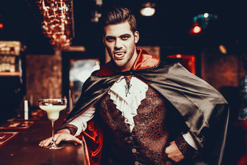 Wall Mural - Portrait of Young Man in Vampire Costume at Party