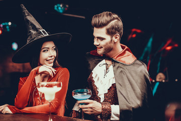 Wall Mural - Young Man and Woman in Costumes at Halloween Party