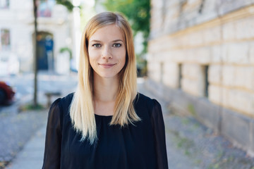 Confident young woman dressed in black shirt