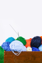 Bright colorful balls of yarn on white background.