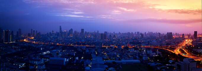 panorama of cityscape with sunrise skyline and expressway light