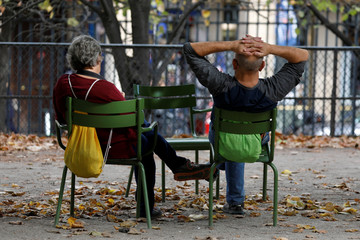 Elderly people sit in the Jardin des Tuileries in Paris, France