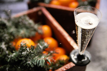 a glass of champagne and a box of tangerines