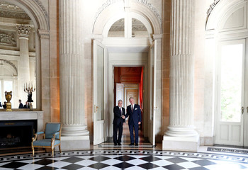 Chile's President Pinera poses with Belgium's King Philippe in Brussels