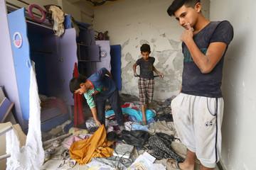 Boys search for belongings in Raqqa