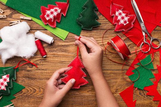 Making of handmade christmas toys from felt