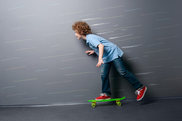 Little skateboarder is gaining speed