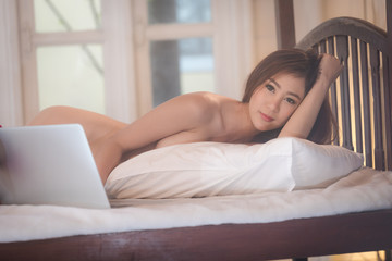 young woman asian girl sexy lady sleep naked playing laptop