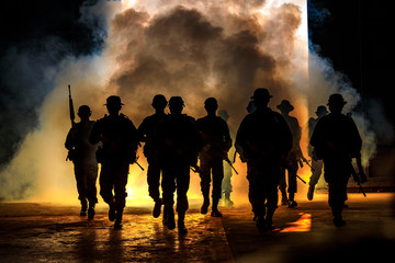 soldiers walkers carry weapon of fire