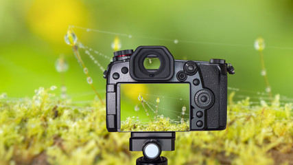 Digital camera on Macro waterdrop background 1