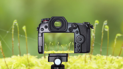 Digital camera on Macro waterdrop background 2