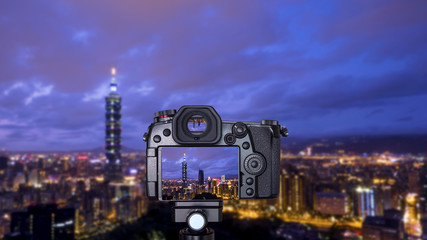 Digital camera on cityscape blur background 2