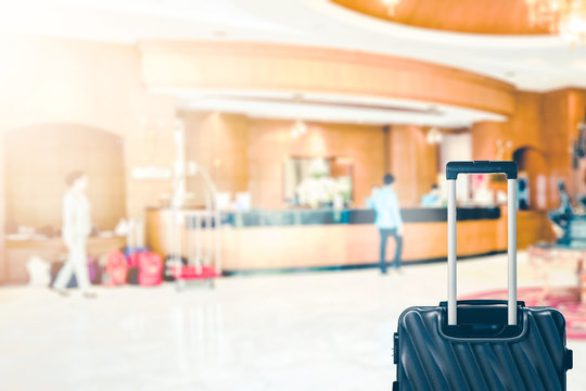 Abstract Blur hotel lobby with receptionist and luggage bag for background